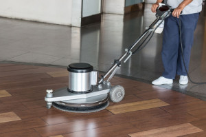 57109192 - woman worker cleaning the floor with polishing machine